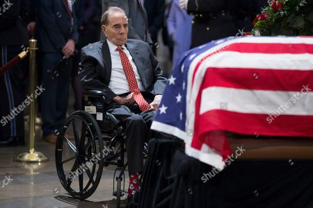 Former US Senate Majority Leader Bob Dole pay his respects at the casket bearing the remains of former US President George H.W. Bush in the Rotunda of the US Capitol in Washington, DC, USA, 04 December 2018. Bush, the 41st President of the United States (1989-1993), died in his Houston, Texas, USA, home surrounded by family and friends on 30 November 2018.