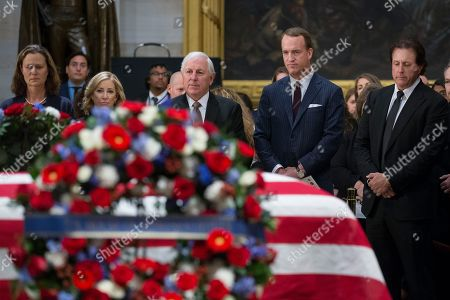 Stock Picture of Retired US American football player Peyton Manning (2-R), joins retired golfer Pam Shriver (L), retired tennis player Chris Evert (2-L), retired golfer Hale Irwin (C) and golfer Phil Mickelson (R), as they pay their respects at the casket bearing the remains of former US President George H.W. Bush in the Rotunda of the US Capitol in Washington, DC, USA, 04 December 2018. Bush, the 41st President of the United States (1989-1993), died in his Houston, Texas, USA, home surrounded by family and friends on 30 November 2018.