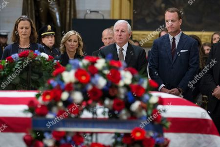 Retired American football player Peyton Manning (R), joins retired golfer Pam Shriver (L), retired tennis player Chris Evert (2-L), and retired golfer Hale Irwin (C) as they pay their respects at the casket bearing the remains of former US President George H.W. Bush in the Rotunda of the US Capitol in Washington, DC, USA, 04 December 2018. Bush, the 41st President of the United States (1989-1993), died in his Houston, Texas, USA, home surrounded by family and friends on 30 November 2018.