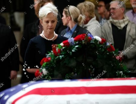 Stock Picture of Cindy McCain, widow of the late Sen. John McCain pays her respects to the flag-draped casket containing the body of former US President George H.W. Bush lying in state in the Rotunda of the US Capitol in Washington, DC, USA, 04 December 2018.  George H.W. Bush, the 41st President of the United States (1989-1993), died at the age of 94 on 30 November 2018 at his home in Texas.
