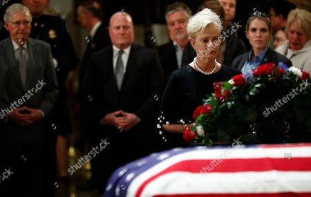 Cindy McCain, widow of the late Sen. John McCain pays her respects to the flag-draped casket containing the body of former US President George H.W. Bush lying in state in the Rotunda of the US Capitol in Washington, DC, USA, 04 December 2018.  George H.W. Bush, the 41st President of the United States (1989-1993), died at the age of 94 on 30 November 2018 at his home in Texas.