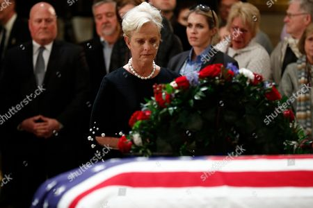 Stock Image of Cindy McCain, widow of the late Sen. John McCain pays her respects to the flag-draped casket containing the body of former US President George H.W. Bush lying in state in the Rotunda of the US Capitol in Washington, DC, USA, 04 December 2018.  George H.W. Bush, the 41st President of the United States (1989-1993), died at the age of 94 on 30 November 2018 at his home in Texas.