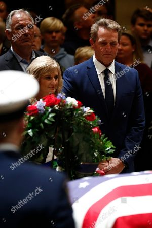 Republican Senator from Arizona Jeff Flake (R) and wife Cheryl Flake (C) pay their respects to the casket containing the body of former US President George H.W. Bush at the Rotunda of the US Capitol in Washington, DC, USA, 04 December 2018. George H.W. Bush, the 41st President of the United States (1989-1993), died at the age of 94 on 30 November 2018, at his home in Texas.