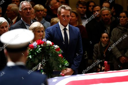 Republican Senator from Arizona Jeff Flake (R) and wife Cheryl Flake (2-R) pay their respects to the casket containing the body of former US President George H.W. Bush at the Rotunda of the US Capitol in Washington, DC, USA, 04 December 2018. George H.W. Bush, the 41st President of the United States (1989-1993), died at the age of 94 on 30 November 2018, at his home in Texas.