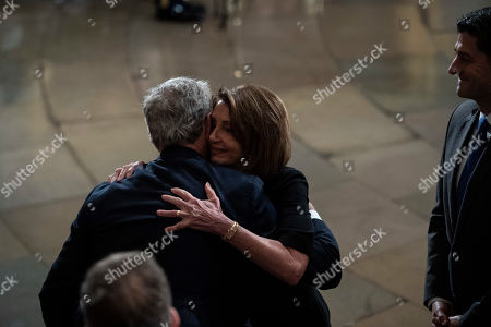 Outgoing Speaker Paul D. Ryan (R) and US Representative Nancy Pelosi (C) greet former president George W. Bush (L) after paying their respects to former president George H.W. Bush as he lies in State at the US Capitol Rotunda on Capitol Hill in Washington, DC, USA, 03 December 2018. George H.W. Bush, the 41st President of the United States (1989-1993), died at the age of 94 on 30 November 2018 at his home in Texas.