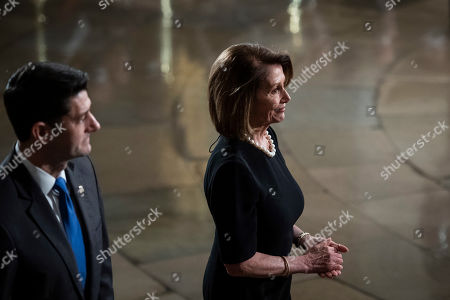 Outgoing Speaker Paul D. Ryan (L) and US Representative Nancy Pelosi (R) walk away after paying their respects to former president George H.W. Bush as he lies in State at the US Capitol Rotunda on Capitol Hill in Washington, DC, USA, 03 December 2018. George H.W. Bush, the 41st President of the United States (1989-1993), died at the age of 94 on 30 November 2018 at his home in Texas.
