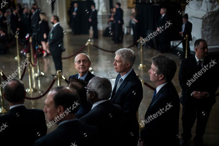 Supreme Court Associate Justice Stephen Breyer, Associate Justice Neil M. Gorsuch, and Associate Justice Brett M. Kavanaugh wait for the arrival of Former president George H.W. Bush to lie in State at the U.S. Capitol Rotunda on Capitol Hill