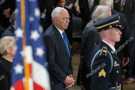 Former US Secretary of State Colin Powell (C) pays his repsects in front of the casket bearing the body of former US President George H.W. Bush, in the Rotunda of the US Capitol in Washington, DC, USA, 03 December 2018. Bush, the 41st President of the United States (1989-1993), died in his Houston, Texas, USA, home surrounded by family and friends on 30 November 2018. The body will lie in state in the Capitol before being moved to the Washington National Cathedral for a funeral service. It will then return to Houston for another funeral service before being transported by train to the George Bush Presidential Library and Museum for internment.