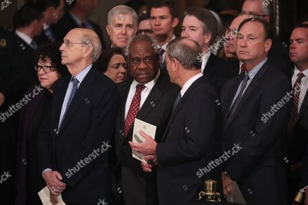 Justices of the U.S. Supreme Court including (L-R) Associate Justices Judge Sonia Sotomayor, Stephen Breyer, Elena Kagan, Neil Gorsuch, Clarence Thomas, Chief Justice John Roberts, Associate Justice Brett Kavanaugh, former Associate Justice Anthony Kennedy and Associate Justice Samuel Alito await the arrival of the casket of former U.S. President George H.W. Bush inside the U.S. Capitol Rotunda, where it will lie in state