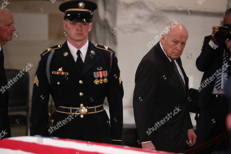 Former Vice President Dick Cheney walks past the casket of former President George H.W. Bush as it lies in state in the U.S. Capitol Rotunda