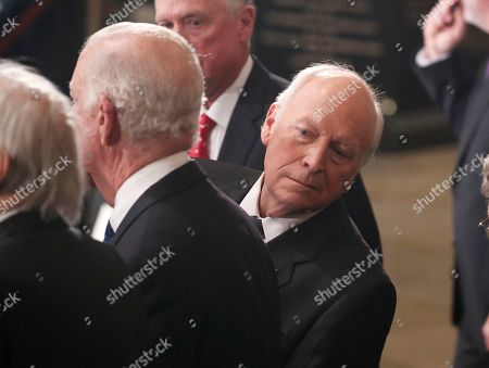 Former U.S. Vice President Dick Cheney looks behind former Secretary of State James Baker as he stands next to former Vice President Dan Quayle (rear) during memorial ceremonies for former President George H.W. Bush in the U.S. Capitol Rotunda