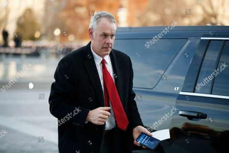 Stock Picture of US Secretary of the Interior Ryan Zinke arrives at the US Capitol prior to the service for former President George H. W. Bush