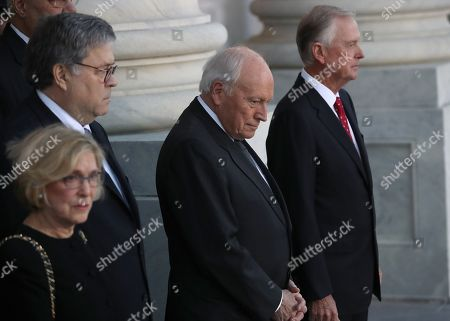 Former U.S. Vice President Dick Cheney (2nd R) and former U.S. Vice President Dan Quayle (R) await the arrival of the procession carrying the casket of former U.S. President George H. W. Bush at the U.S. Capitol.