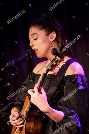 Kira Kosarin sings at her showcase at The Century Club, London, ahead of the release of her single 'Vinyl'
