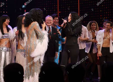 """Stephanie J. Bloch, Cher. Actress Stephanie J. Bloch, left, and Cher sing """"If I Could Turn Back Time"""" together on stage during the curtain call for """"The Cher Show"""" Broadway musical opening night at the Neil Simon Theatre, in New York"""