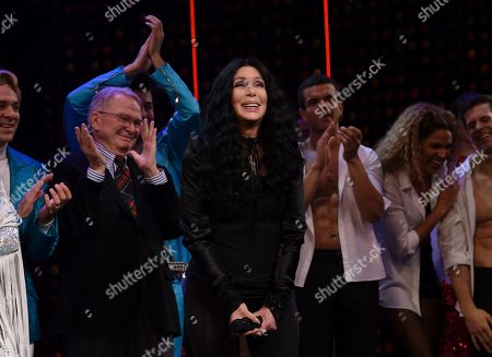 """Cher takes a bow on stage with designer Bob Mackie behind her during the curtain call for """"The Cher Show"""" Broadway musical opening night at the Neil Simon Theatre, in New York"""