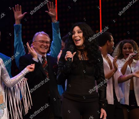 """Bob Mackie, Cher. Cher sings """"If I Could Turn Back Time"""" on stage with designer Bob Mackie standing behind her during the curtain call for """"The Cher Show"""" Broadway musical opening night at the Neil Simon Theatre, in New York"""