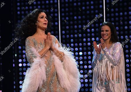 """Stephanie J. Block, Teal Wicks. Actors Stephanie J. Block, left, and Teal Wicks on stage during the curtain for """"The Cher Show"""" Broadway musical opening night at the Neil Simon Theatre, in New York"""