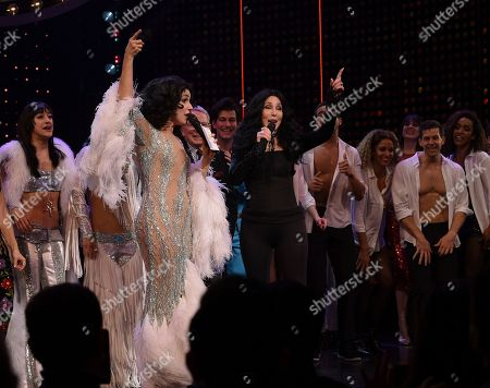 """Stephanie J. Block, Cher. Actress Stephanie J. Block, left, and Cher sing """"If I Could Turn Back Time"""" together on stage during the curtain call for """"The Cher Show"""" Broadway musical opening night at the Neil Simon Theatre, in New York"""