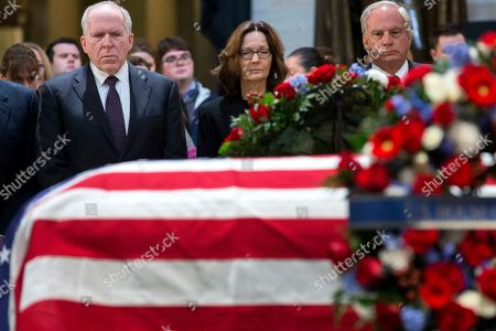 Director of the Central Intelligence Agency (CIA) Gina Haspel (C), former CIA Director John Brennan (L), and former CIA Director Porter Goss (R) pay their respects in front of the casket bearing the body of former US President George H.W. Bush, in the Rotunda of the US Capitol in Washington, DC, USA, 03 December 2018. Bush, the 41st President of the United States (1989-1993), died in his Houston, Texas, USA, home surrounded by family and friends on 30 November 2018.