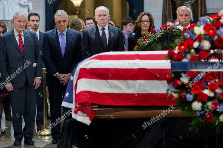 Director of the Central Intelligence Agency (CIA) Gina Haspel (2-R) joins former CIA Directors; William Webster (L), George Tenet (2-L), John Brennan (C), and Porter Goss (R) in paying respects in front of the casket bearing the body of former US President George H.W. Bush, in the Rotunda of the US Capitol in Washington, DC, USA, 04 December 2018. Bush, the 41st President of the United States (1989-1993), died in his Houston, Texas, USA, home surrounded by family and friends on 30 November 2018.