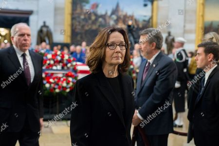 Director of the Central Intelligence Agency (CIA) Gina Haspel (C) joins former CIA Directors such as John Brennan (L) in visiting the casket bearing the body of former US President George H.W. Bush in the Rotunda of the US Capitol in Washington, DC, USA, 04 December 2018. Bush, the 41st President of the United States (1989-1993), died in his Houston, Texas, USA, home surrounded by family and friends on 30 November 2018.