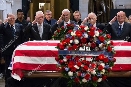 Former US Secretary of State Colin Powell (C) and US military Operation Desert Storm Commanders salute in front of the casket bearing the body of former US President George H.W. Bush in the Rotunda of the US Capitol in Washington, DC, USA, 04 December 2018. Bush will lie in state in the Capitol Rotunda before his state funeral at the Washington National Cathedral 05 December. George H.W. Bush, the 41st President of the United States (1989-1993), died at the age of 94 on 30 November 2018 at his home in Texas.