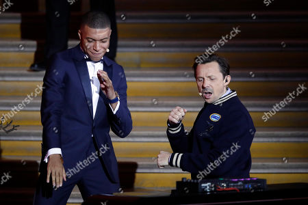 """Stock Image of Paris St Germain's Kylian Mbappe, left, celebrates with DJ Martin Solveig after receiving the Kopa Trophy during the Golden Ball, """"Ballon d'Or"""" award ceremony at the Grand Palais in Paris, France, Monday, Dec.3, 2018. Awarded every year by France Football magazine since Stanley Matthews won it in 1956, the Ballon d'Or, Golden Ball for the best player of the year will be given to both a woman and a man"""