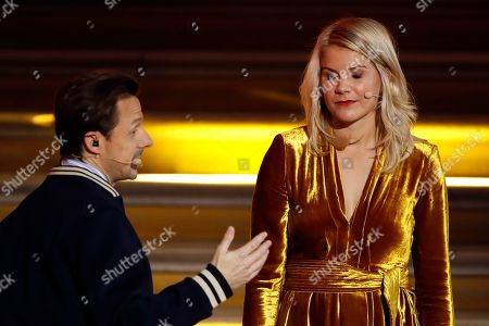 French DJ and musician Martin Solveig, left, talks to Olympique Lyonnais' Ada Hegerberg, of Norway, during the Golden Ball (Ballon d'Or) award ceremony at the Grand Palais in Paris. After asking the first woman to win the Ballon d'Or if she twerked, French DJ Martin Solveig then said sorry