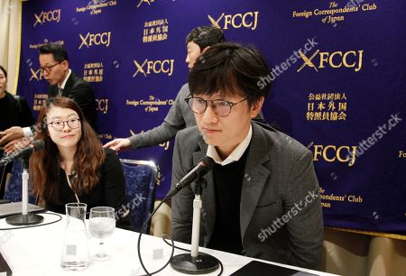 Plaintiffs' attorneys Lim Jae-sung, right, and Kim Se-eun, left, take seats for a press conference in Tokyo, . The two lawyers for Korean forced laborers demanded Nippon Steel & Sumitomo Metal Corp., a Japanese steelmaker, respond to their request to discuss compensation by Christmas, or they will take legal step to freeze its assets in their country. South Korea's top court ordered Nippon Steel to compensate 100 million won ($87,680) each to four plaintiffs forced to work at the company during Japan's colonial rule of the Korean Peninsula