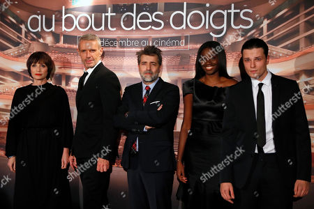 "Kristin Scott Thomas Lambert Wilson, director Ludovic Bernard, Karidja Toure and Jules Benchetrit pose during a photocall for the screening of ""Au Bout Des Doigts"" in Paris"