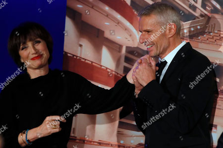 "Kristin Scott Thomas, left, and Lambert Wilson pose during a photocall for the screening of ""Au Bout Des Doigts"" in Paris"