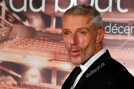 "Lambert Wilson poses during a photocall for the screening of ""Au Bout Des Doigts"" in Paris"