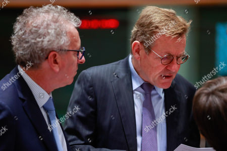 Luxembourg's Finance Minister Pierre Gramegna (L) and Belgian Finance Minister Johan Van Overtveldt (R) at the start of an Economic and Financial affairs meeting council (ECOFIN) at the European Council in Brussels, Belgium, 04 December 2018.