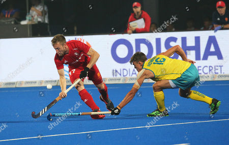 Australia's Tim Howard (R) in action against Barry Middleton (L) of England during the men's Field Hockey World Cup match between England and Australia at the Kalinga Stadium in Bhubaneswar, India, 04 December 2018.