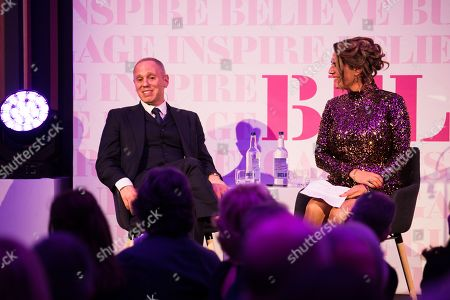 Stock Picture of Rob Rinder in conversation with Samantha Simmonds.
