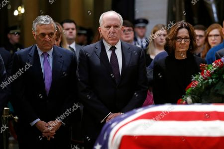 George Tenet, John Brennan, Gina Haspel. Former CIA directors George Tenet, left, and John Brennan pause alongside current director Gina Haspel in front of the flag-draped casket of former President George H.W. Bush as he lies in state in the Capitol Rotunda in Washington