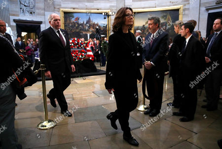 Gina Haspel, John Brennan. CIA director Gina Haspel, center, and former director John Brennan, left, depart the Capitol Rotunda after visiting the flag-draped casket of former President George H.W. Bush as he lies in state in Washington