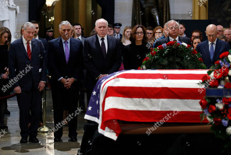 Gina Haspel, William Webster, George Tenet, John Brennan, Porter Goss, James Woolsey. CIA director Gina Haspel, third from right, pauses alongside former intelligence directors William Webster, from left, George Tenet, John Brennan, Porter Goss and James Woolsey in front of the flag-draped casket of former President George H.W. Bush as he lies in state in the Capitol Rotunda in Washington