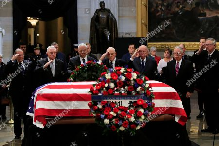 Former Secretary of State Colin Powell, third from left, leads former Operation Desert Storm commanders as they pay their last respects to former President George H.W. Bush as he lies in state at the U.S. Capitol in Washington