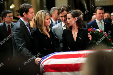 Jenna Bush Hager, Henry Hager, Barbara Bush, Craig Coyne. Jenna Bush Hager, second from left, her husband Henry Hager, left, her twin sister Barbara Bush, right, and Barbara's husband Craig Coyne, second from right, gather around the flag-draped casket of their grandfather, former President George H.W. Bush as he lie in state at the U.S. Capitol in Washington