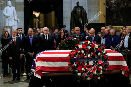 Gina Haspel, William Webster, George Tenet, John Brennan, Haspel, Porter Goss, James Woolsey. CIA Director Gina Haspel together with former CIA Directors, from left, William Webster, George Tenet, John Brennan, Haspel, Porter Goss and James Woolsey, pay their last respect to former President George H.W. Bush as he lie in state at the U.S. Capitol in Washington