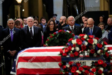 Gina Haspel, George Tenet, John Brennan, Haspel, Porter Goss, James Woolsey. CIA Director Gina Haspel together with former CIA Directors, from left, George Tenet, John Brennan, Haspel, Porter Goss and James Woolsey, pay their last respect to former President George H.W. Bush as he lie in state at the U.S. Capitol in Washington