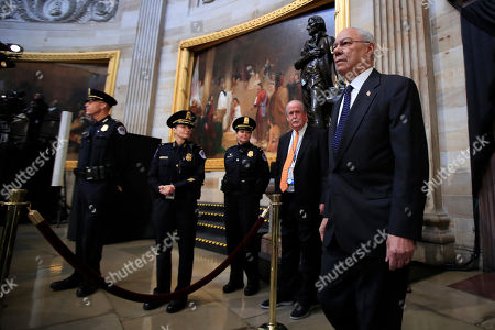 Former Secretary of State Colin Powell, center, leads Desert Storm Commanders to pay their respect to former President George H.W. Bush as he lie in state at the U.S. Capitol in Washington