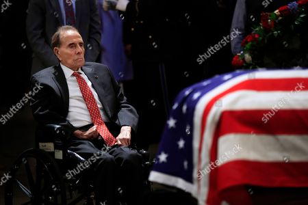 Former Sen. Bob Dole pays his last respects to former President George H.W. Bush as he lies in state at the U.S. Capitol in Washington
