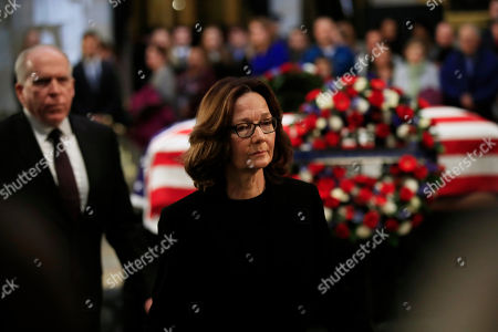 Gina Haspel, John Brennan. CIA Director Gina Haspel, right, together with former CIA Director John Brennan, leave the Capitol Rotunda after paying their last respects to former President George H.W. Bush as he lies in state at the U.S. Capitol in Washington