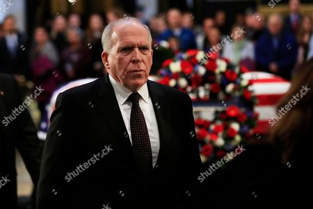 Former CIA Director John Brennan, leaves the Capitol Rotunda after paying his last respects to former President George H.W. Bush as he lies in state at the U.S. Capitol in Washington