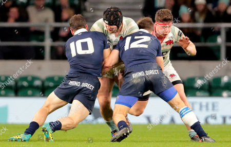 Stock Picture of It takes Mike Phillips of Cambridge and Jake Hennessey of Cambridge to stop Ben Parker of Oxford  during the Varsity match between Oxford and Cambridge at Twickenham on December 6, 2018 in London, England. (Photo by Richard Perriman)
