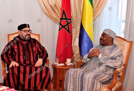 Stock Photo of In this photo dated and provided by the Moroccan News Agency (MAP), Moroccan King Mohammed VI, left, visits Gabonese President Ali Bongo Ondimba at military Hospital in Rabat, Morocco. Gabon's government has released a video showing President Ali Bongo Ondimba meeting with Morocco's king in his first public appearance since Bongo fell ill in October
