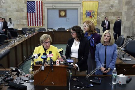New Jersey state Senate Majority Leader Loretta Weinberg, left, D-Teaneck, stands with Assemblywoman Eliana Pintor Marin, second from left, D-Newark, N.J., state Sen. Nancy F. Munoz, second from right, R-Summit, N.J., and Kristin M. Corrado, R-Totowa, N.J., as they address a gathering after Katie Brennan, not seen, the chief of staff at the New Jersey Housing and Mortgage Finance Agency, testified before the Select Oversight Committee at the Statehouse, in Trenton, N.J. Brennan, a top staffer at the state's housing agency who came forward as a sexual assault victim, and has said too little was done about her complaints, which she reported to law enforcement